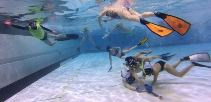Underwater hockey involves players of all ages, genders